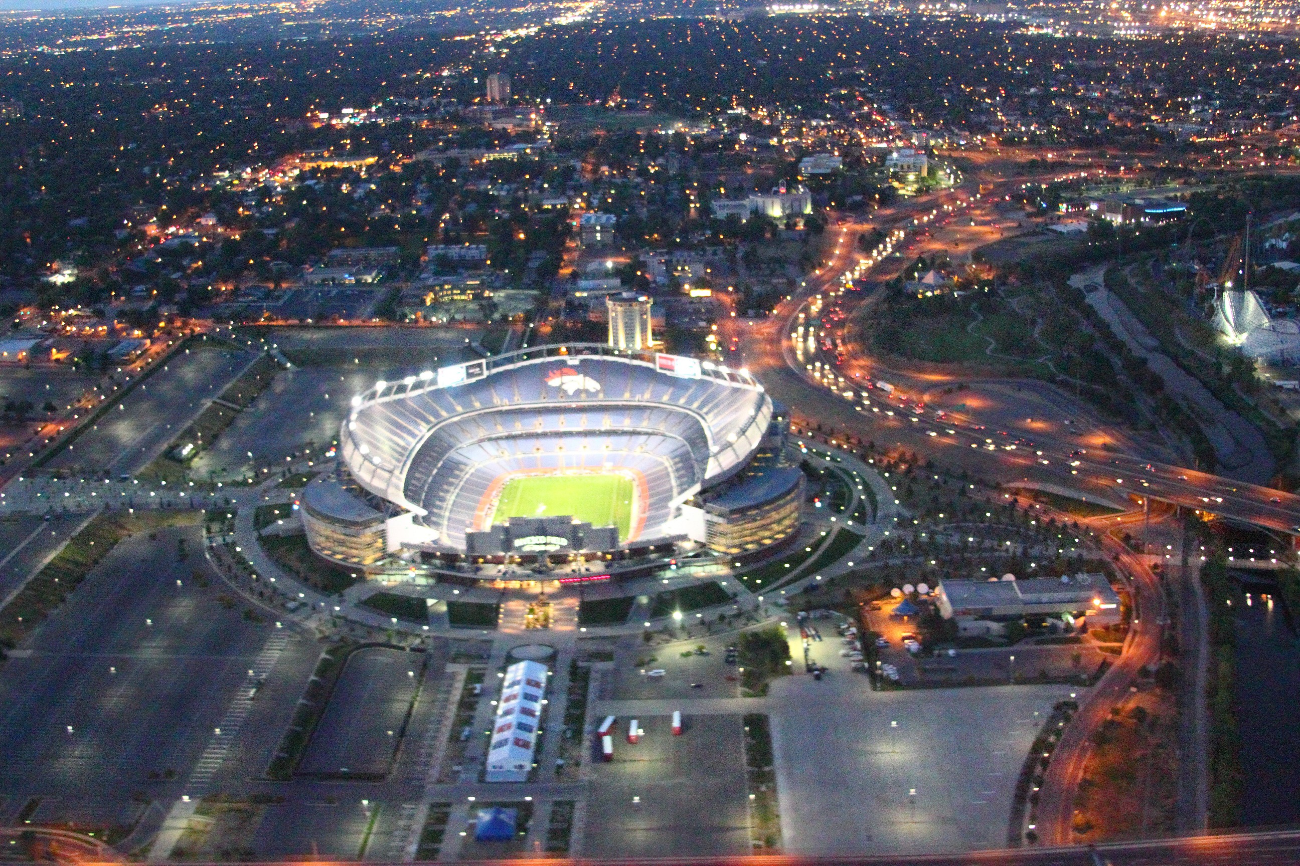 Mile High Stadium, night, from manned helicopter.